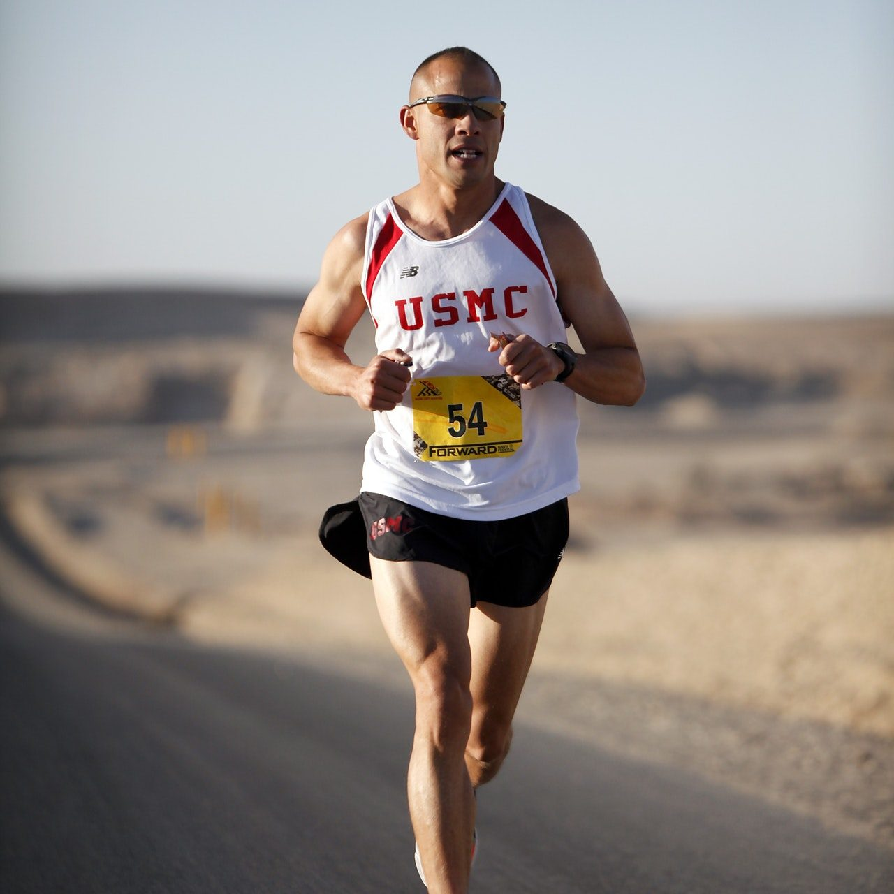 man-in-white-jersey-while-running-35009